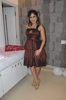 Madhavi Latha Pictures at Naturals Salon Launch in mini gown