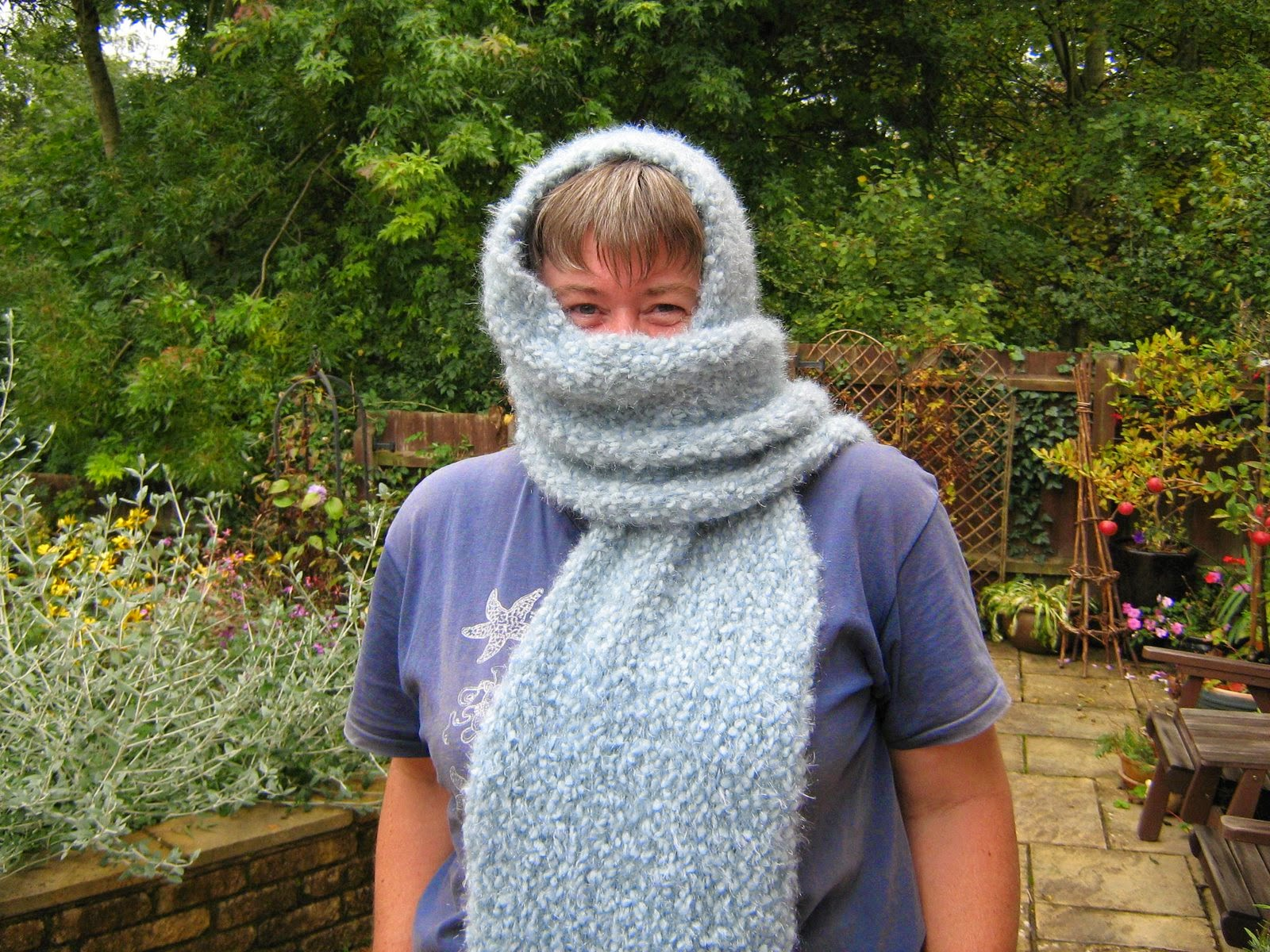 me in my garden wearing a scarf I'd knitted