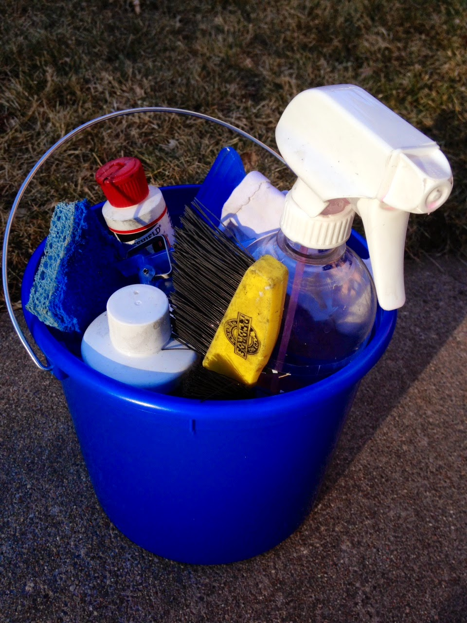 bucket of bike washing supplies