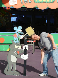 Greg making sure he is the right height for The Simpsons Ride.