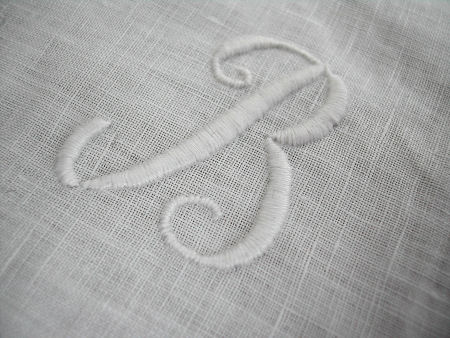 Letters borduren op stof