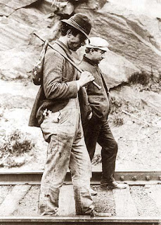 Depression era photo of two hobos walking down railroad tracks