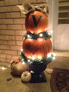 http://www.twoityourself.blogspot.com/2013/10/how-to-make-real-lighted-pumpkin-topiary.html