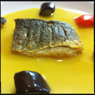 Pan-fried sea bass with beurre blanc & roasted Mediterranean vegetables