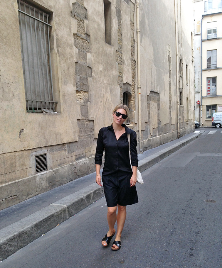 Joseph black sating button down shirt, Tibi culottes, H&M cork slides, Ray-Ban Wayfarers, old Parisian street and stone building, le Marais