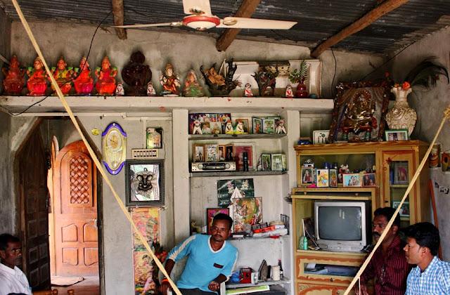 Hindu idols on shelf in living room