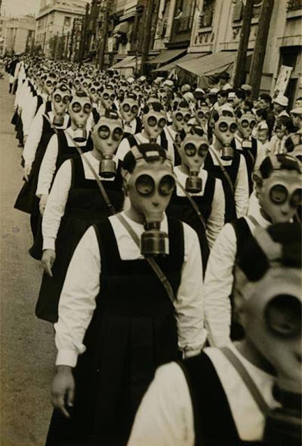 School girls in gas masks. WWII