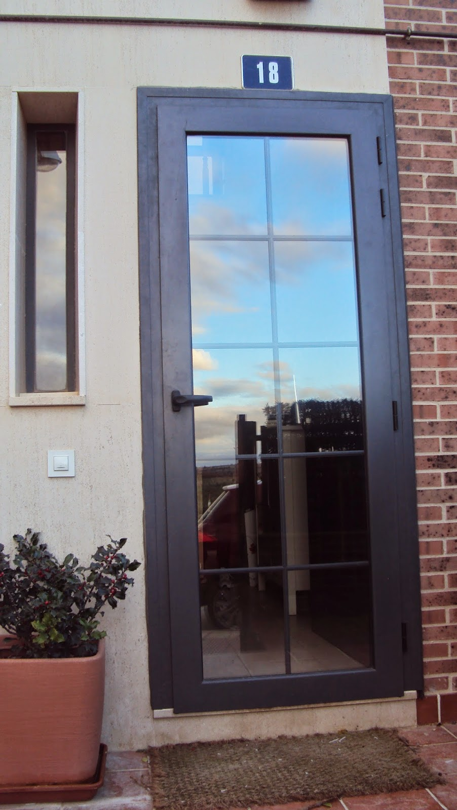Aluminio y cerrajer a abel y cesar santiuste de san juan for Puertas aluminio interior cristal