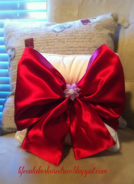"alt=""Easy No Sew Pillow with Red Satin Bow"""