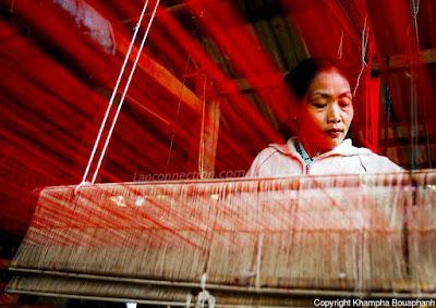 Woman in Luangprabang using the loom to create textile fabric. Photo Credit:  Khampa Bouaphanh