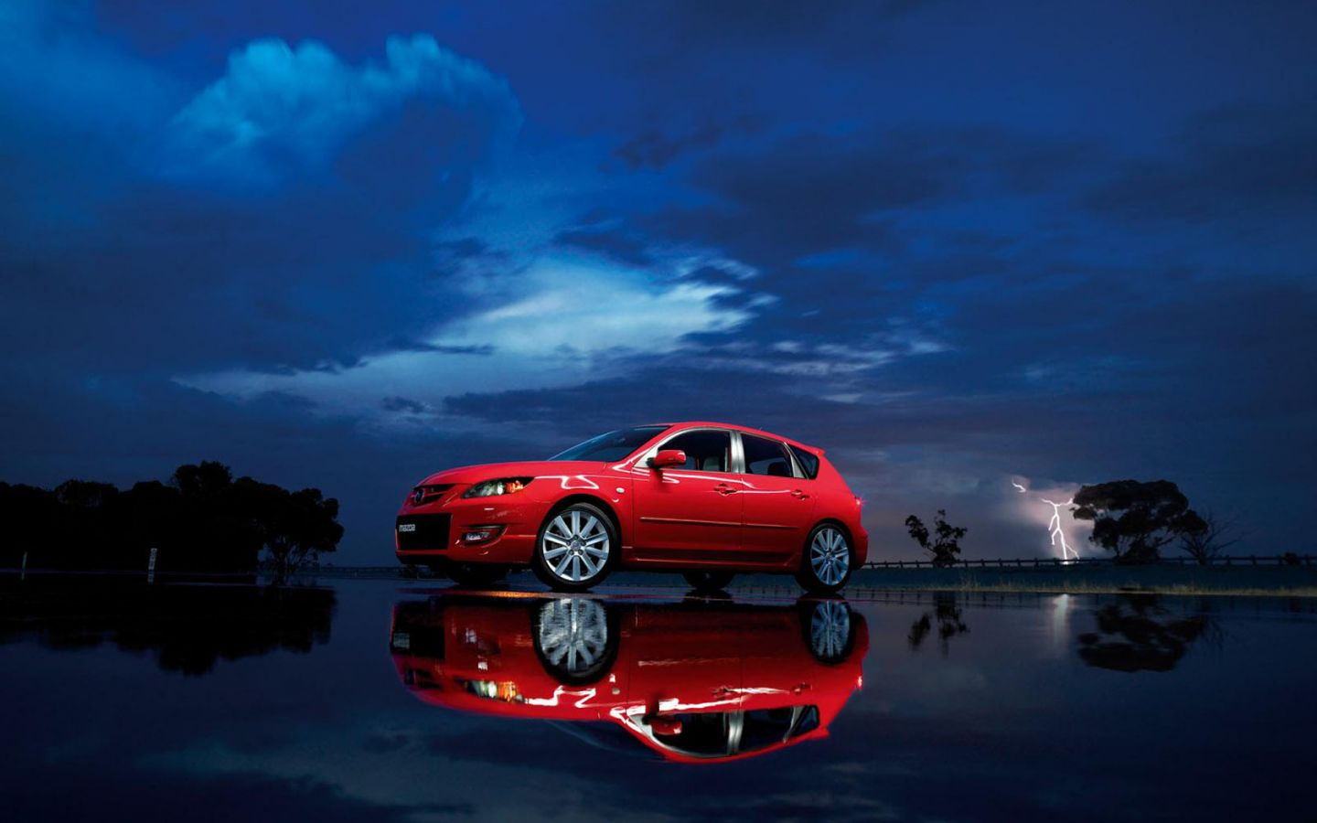 http://1.bp.blogspot.com/-pRe2apAD1bA/TbudmxtQs9I/AAAAAAAAArg/wKsy1b4ymsQ/s1600/mazda_3_mps_red_reflection_wallpaper_-_1440x900.jpg