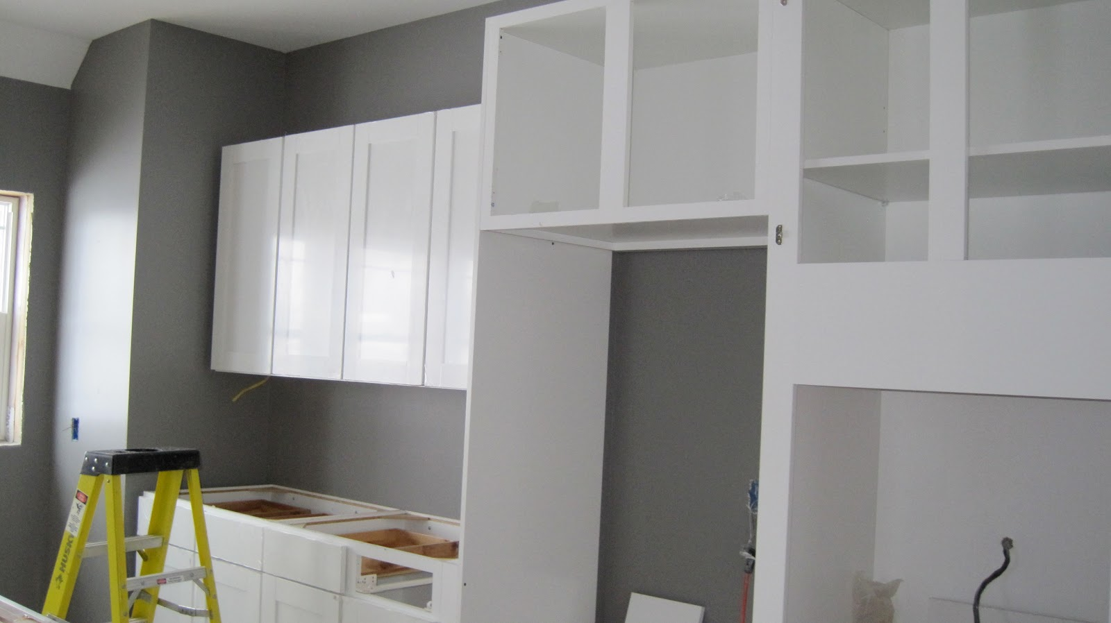 White Kitchen Cabinets with Grey Walls