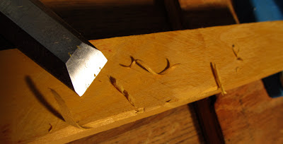 Sharpened chisel shaves yew wood