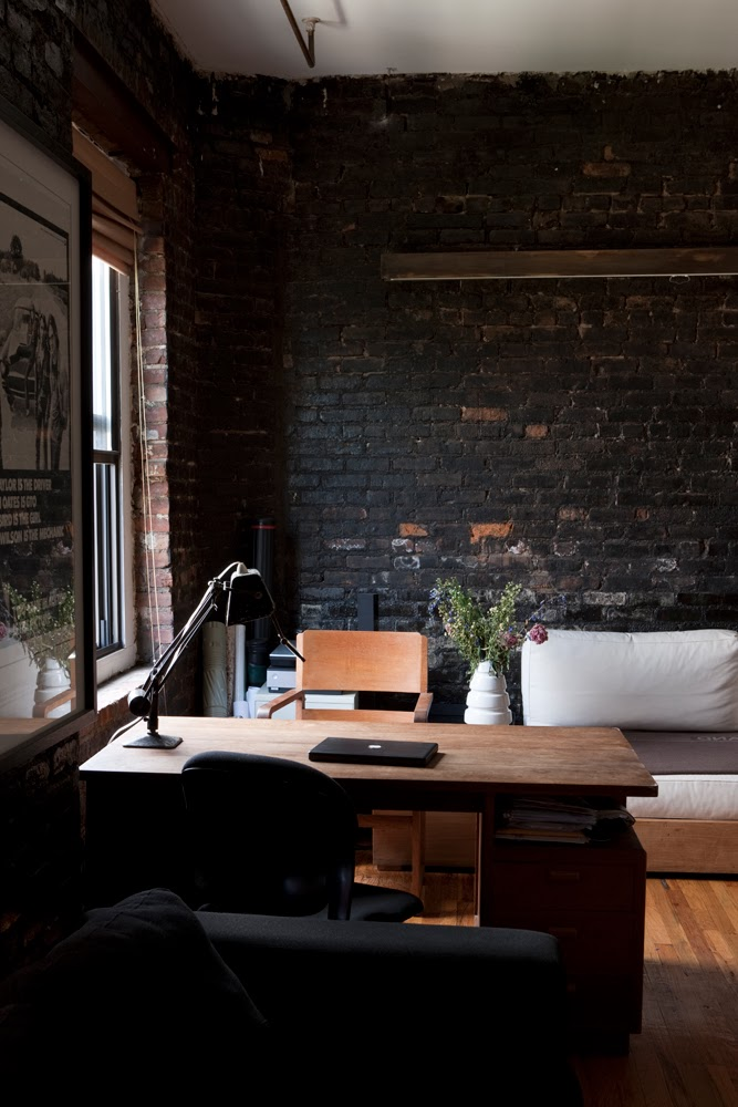 Black brick wall in small loft apartment