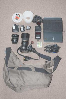 My Lowenpro Passport Sling bag and it's usual contents