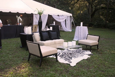 Contemporary outdoor wedding reception lounge with zebra print rug