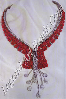 A platinum set necklace of baguette diamonds, supported by a heavy collar of faceted rubies, and finished with nine briolette diamond drops, created by Mauboussin for Yashwant Rao Holkar of Indore in 1937.