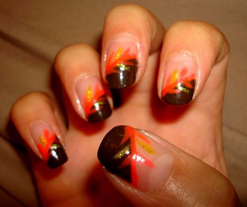 Crystals Nail Designs Brown Tips With Yellow And Orange Design