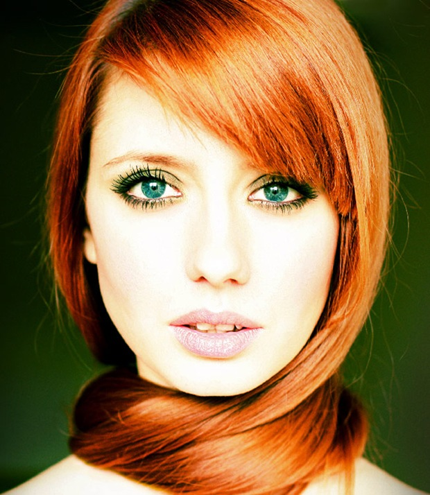 Pretty girl with red head green eyes