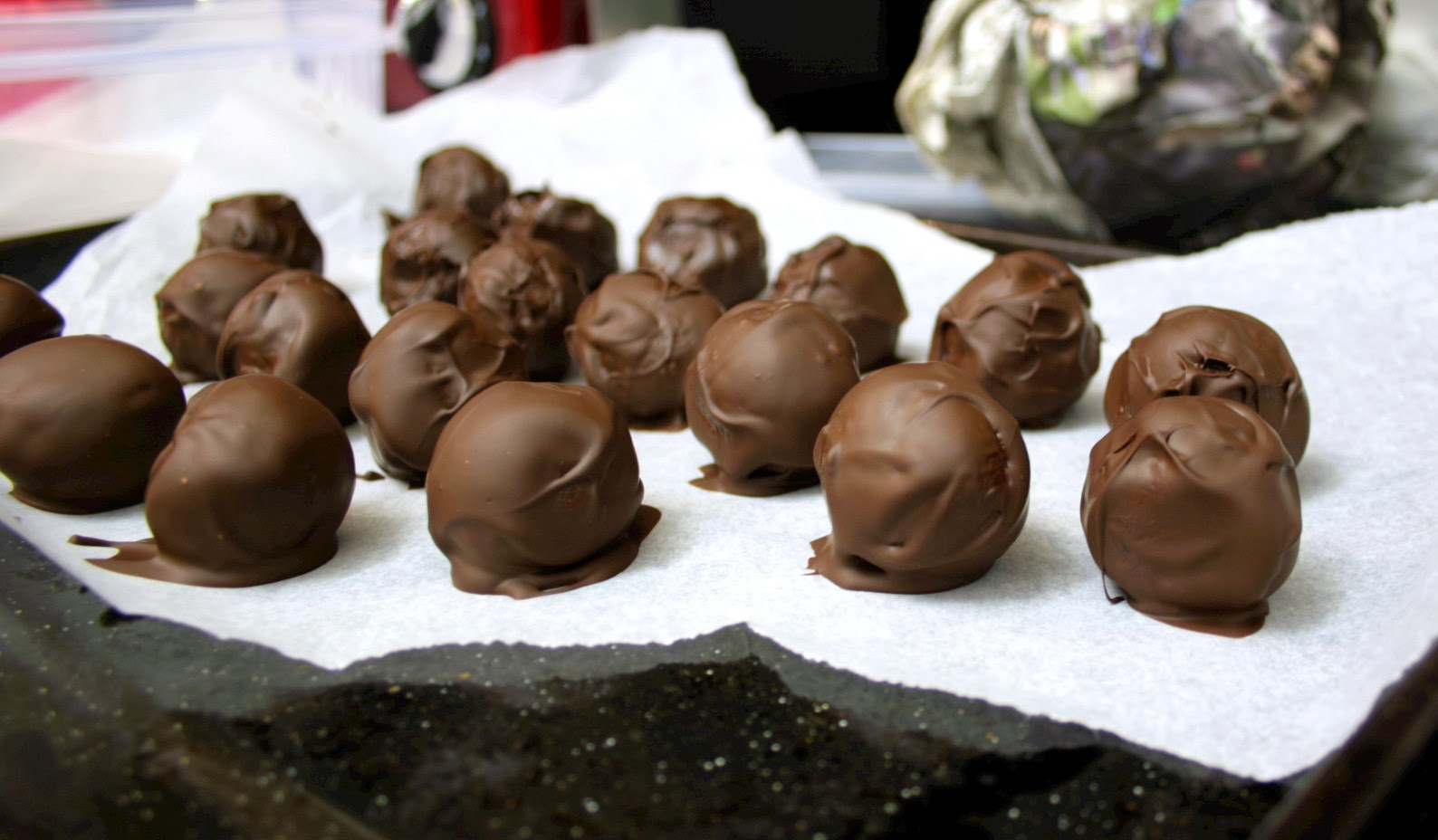 Truffles made from my grandad's recipe, fresh out of their chocolate bath