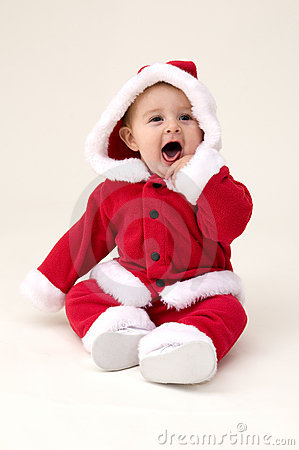 baby girl dressed up in santa costume