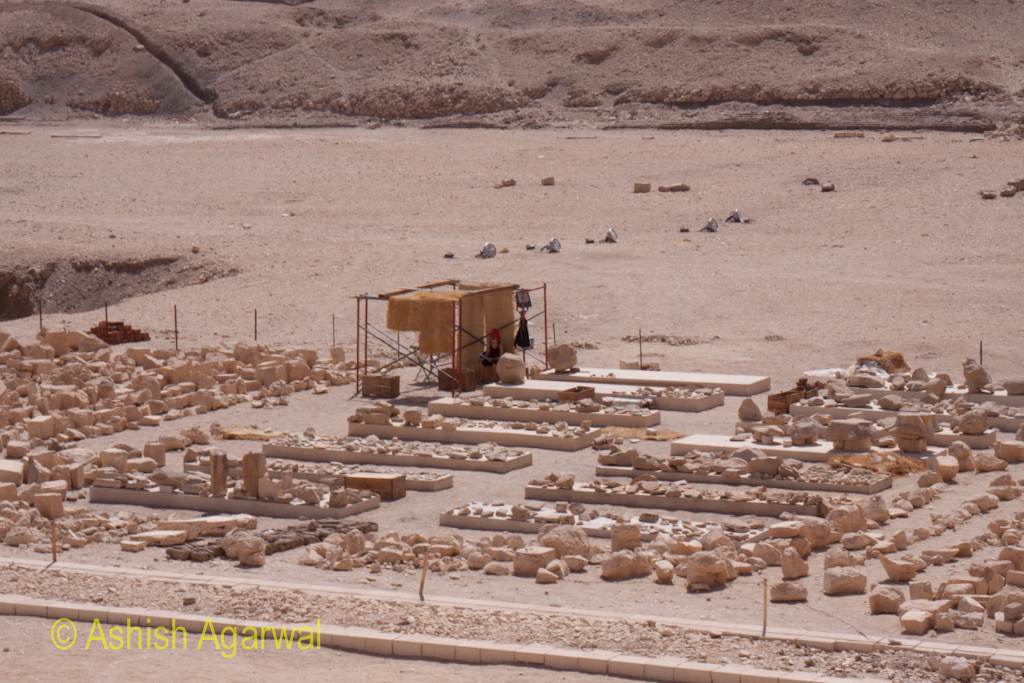 Official in the middle of all the reconstruction material at Hatshepsut mortuary temple