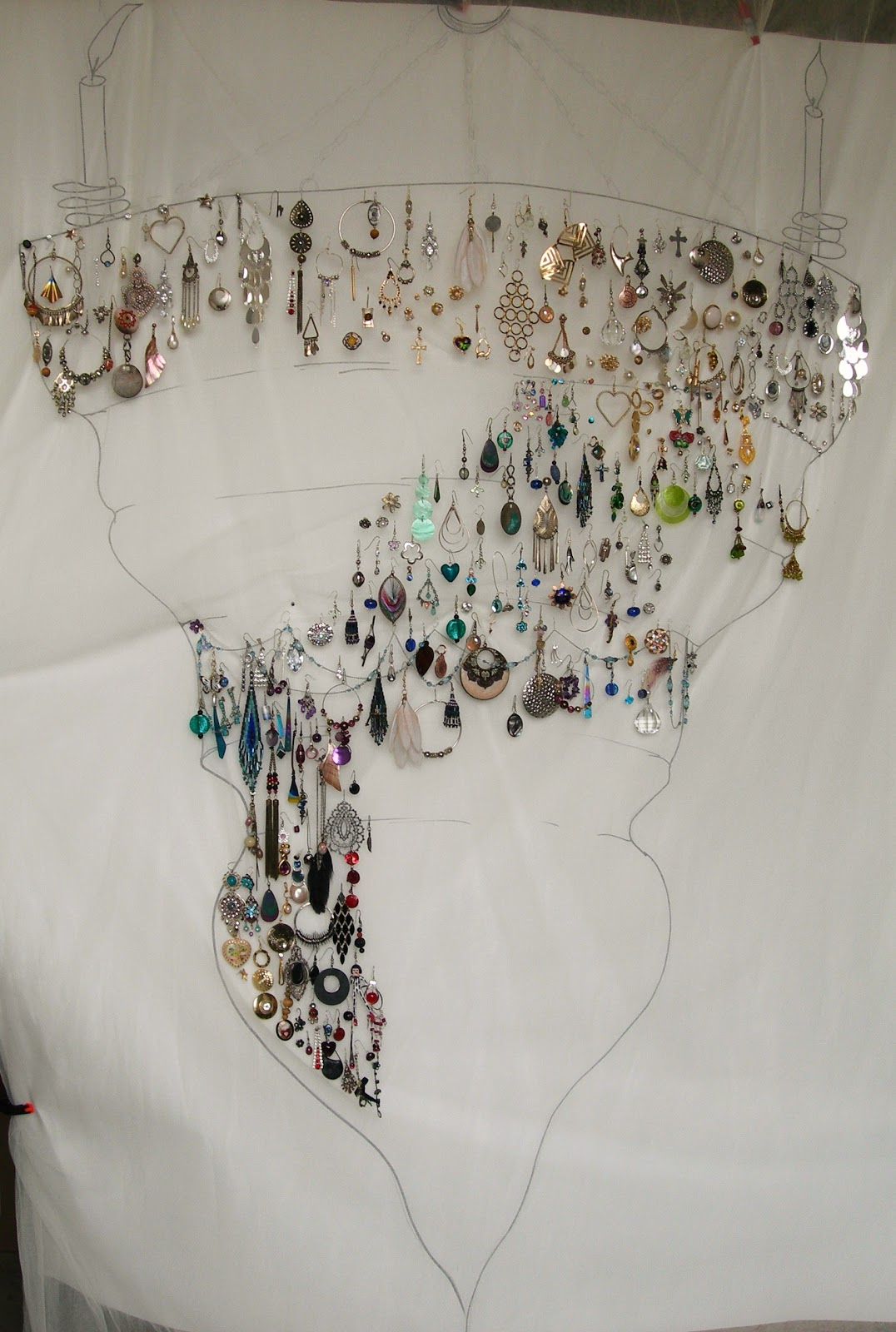donated earrings hanging on gauze