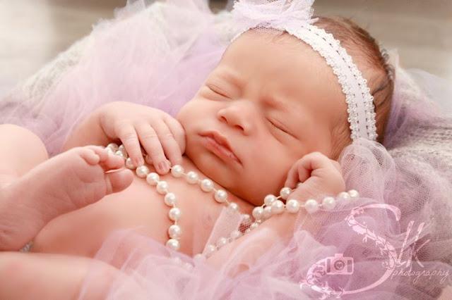 Photographe bébé fille qui dort