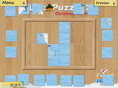 http://www.buzzedgames.com/live-puzzle-2-christmas-game.html