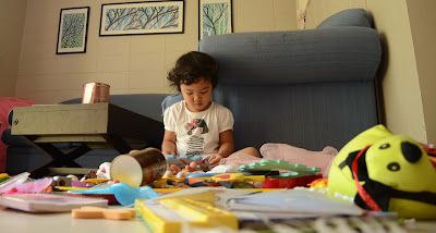 Kecil amidst her toys