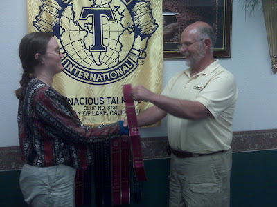 "L to R: Cynthia Parkhill receives Toastmasters ""Select Distinguished"" award ribbon from Jeff Shute"