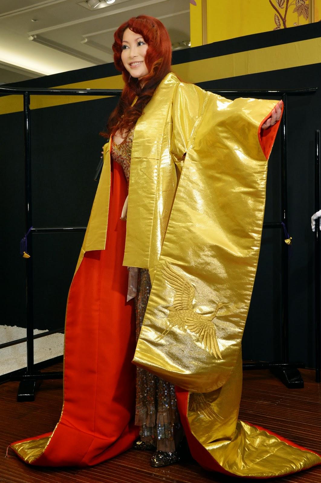 Bridal robe, Business, Chocolate, Economy, Exhibition, Gold, Gold Expo, Gold made products, Hello Kitty doll, Japan, Mika Kano, Million Yen, Panda, Pure Gold, Tokyo, USD, World boxing champion, Yoko Gushiken,