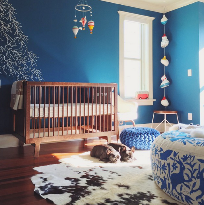 nursery in blue colour with crib from oeuf NY