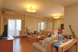 Living room and dining room in 2 bedroom apartment at China World Apartments in Beijing