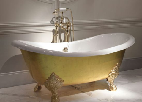 photo of a 24 carat gold leaf covered bathtub
