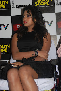 Amla Paul in Mini Skirt Sitting On Chair Spotted at South Scope Magazine Launch Event