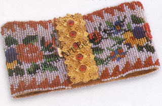 A c.1840`S beadwork bracelet with a pinchbeck clasp set with simulated rubies. These items were almost always sold in pairs. It has a typical Victorian naturalistic flower motif. The beadwork is usually backed by silk.