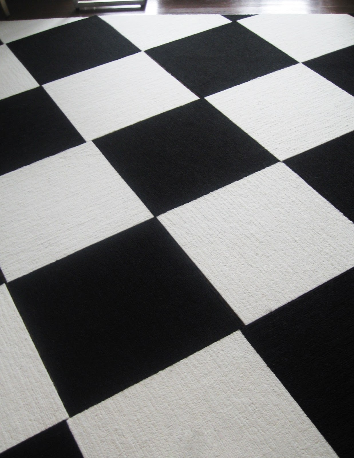 Design Flor Tiles according to braswell flor carpet tiles here is a picture of the in black white pattern as you can see edges had be cut