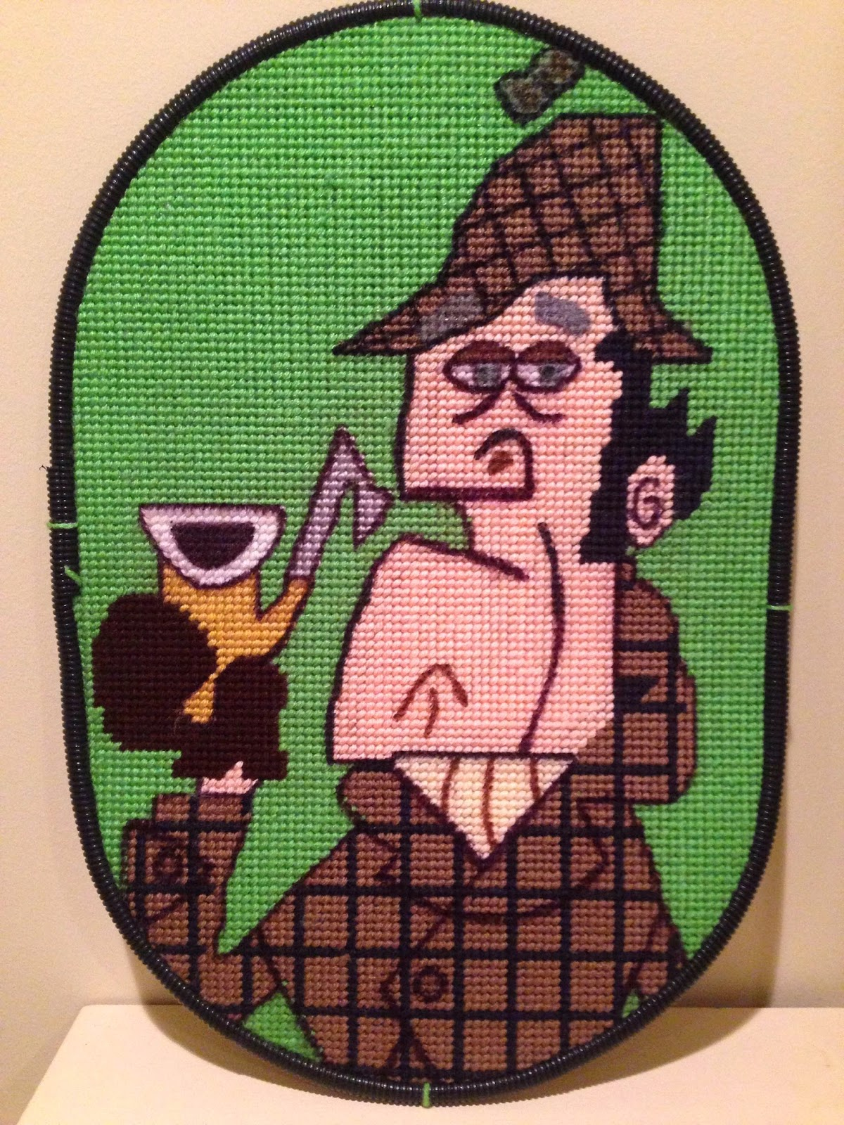 The I Hear of Sherlock Everywhere Sherlock Holmes logo as interpreted in needlepoint.