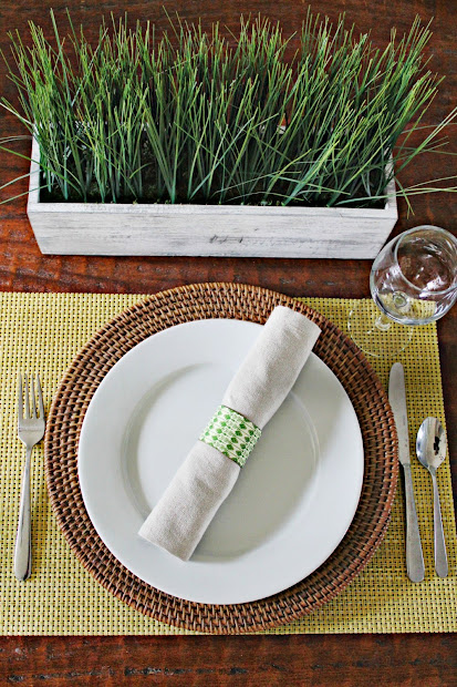 table setting with ikat napkin rings