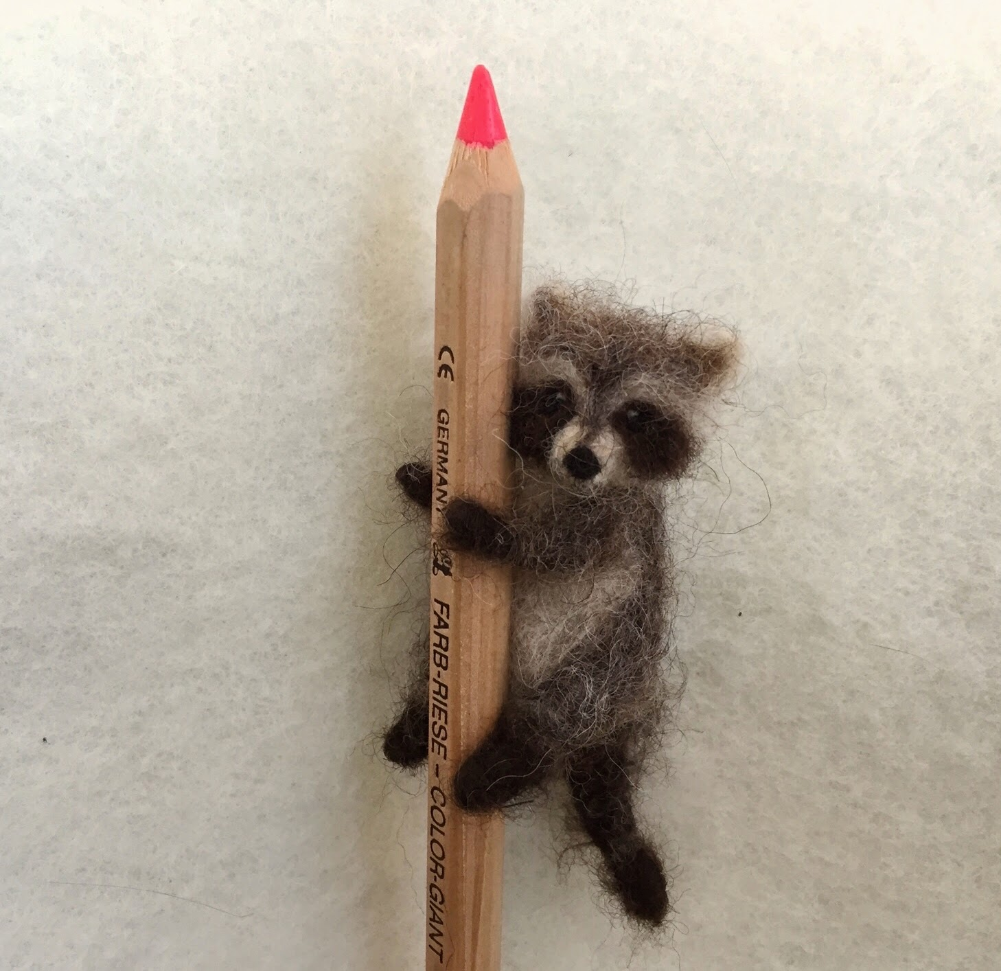 Tiny needle felted racoon
