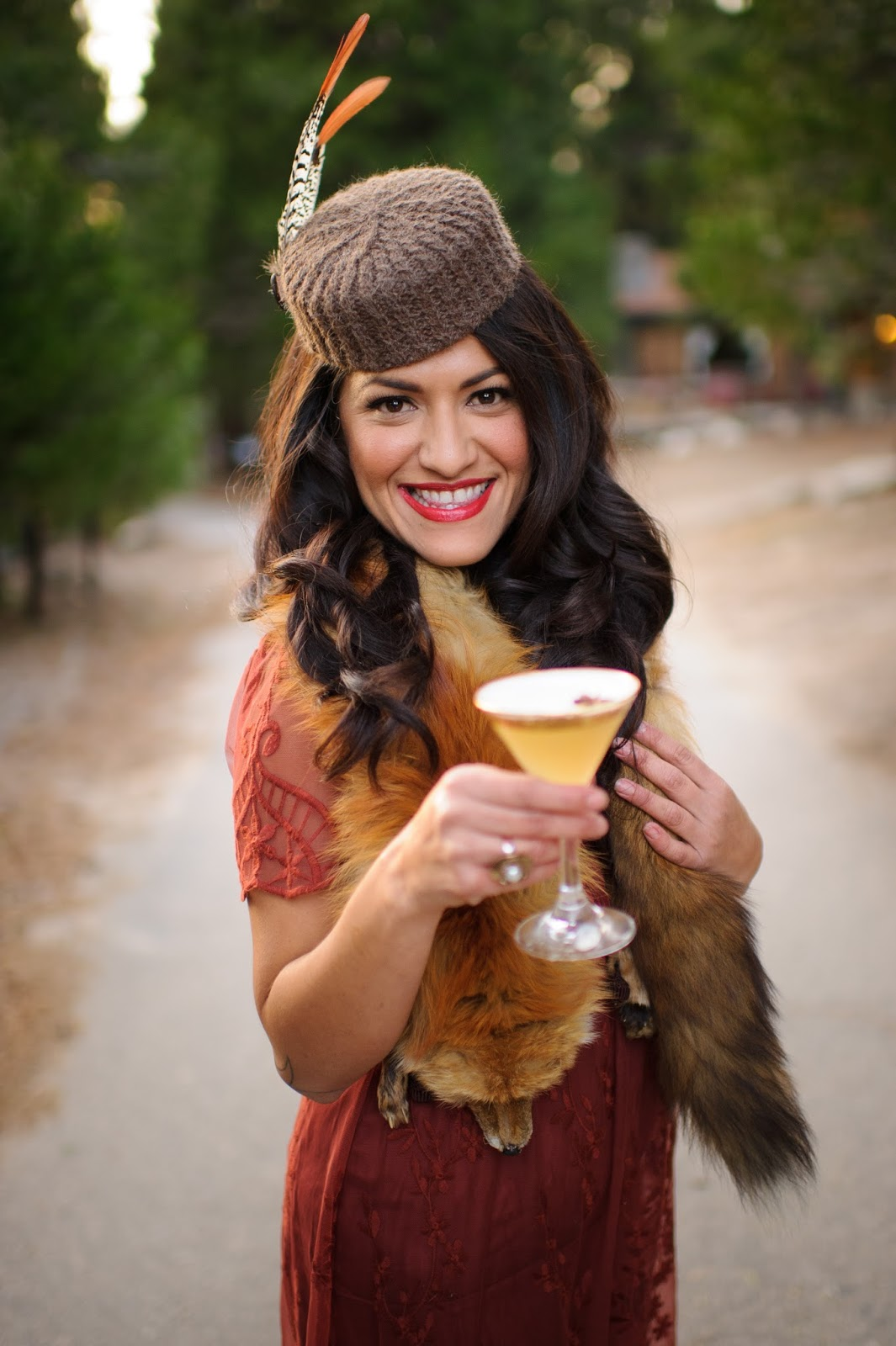 Pamela Trujillo Posing for Sol Bartending while wearing the Pamela Pillbox Hat by White Purls