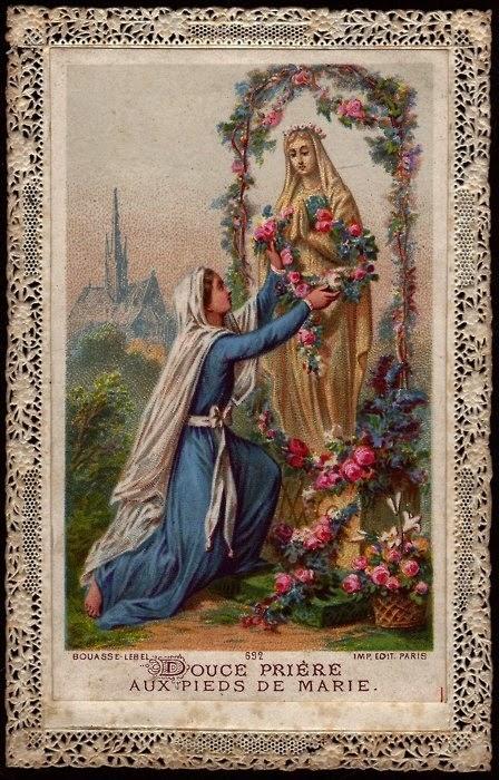 A los pies de María