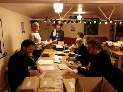 Festival friends and Director Matt Holland busy stuffing envelopes