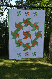 https://www.etsy.com/listing/186323347/baby-quilt-green-and-orange-pinwheels