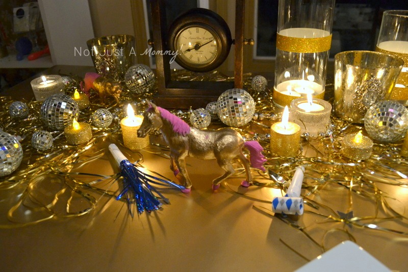 colorful and glittery new year's eve party gold table