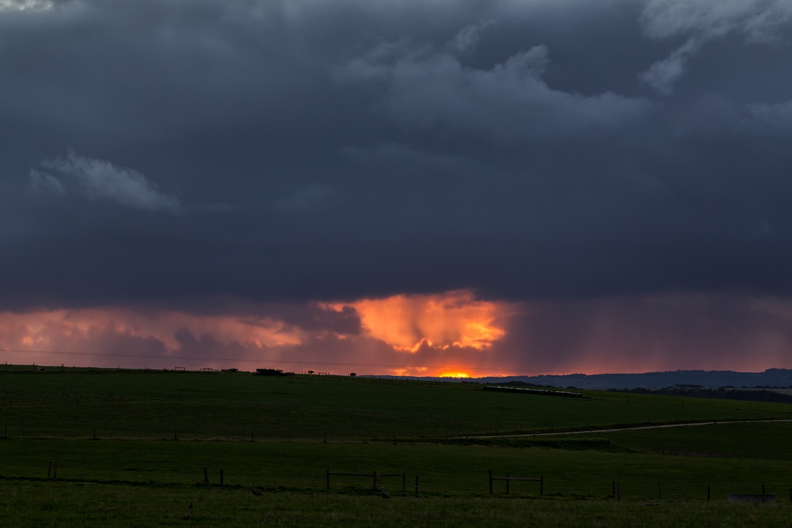 rain clouds during sunset