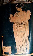 A Muse reading scroll.