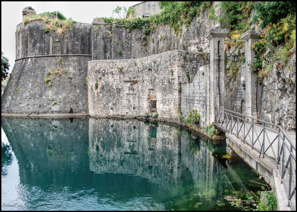 Fortified walls reflected in water, Kotor Montenegro