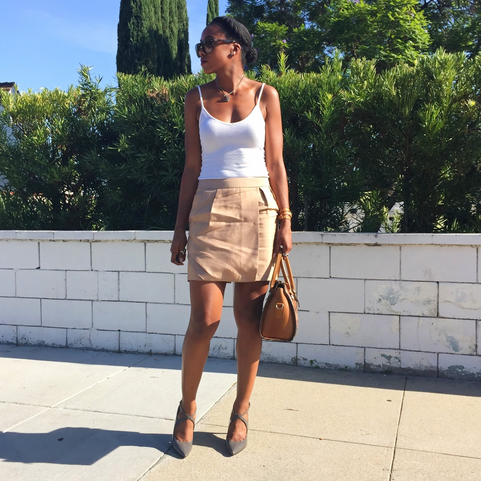 white tank top with faux wrap mini skirt styled with strappy pointed toe pumps